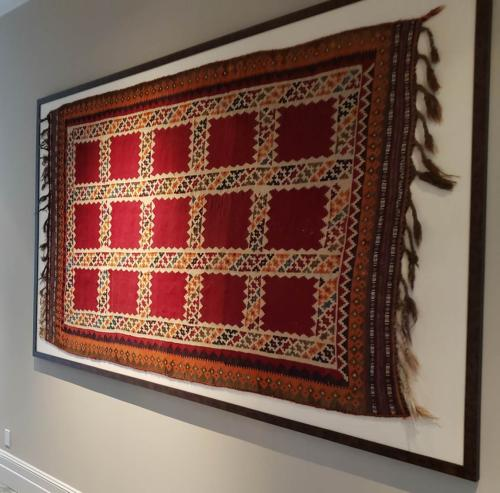 Rug we repaired and washed for hanging in a frame on the wall.